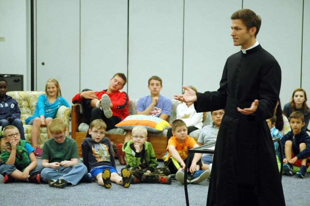 Fr Chase & Kids.jpg